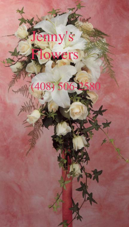 {Casa Blanca lilies bouquet with ivory rose and green ivyy to softens the look.}