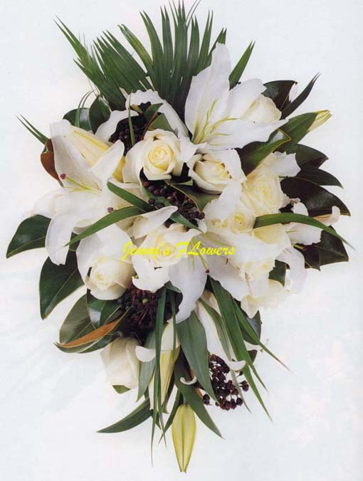 {Teardrop Bouquet with Oriental Lillies, Bianca roses, magnolia leaves, and privet berries}