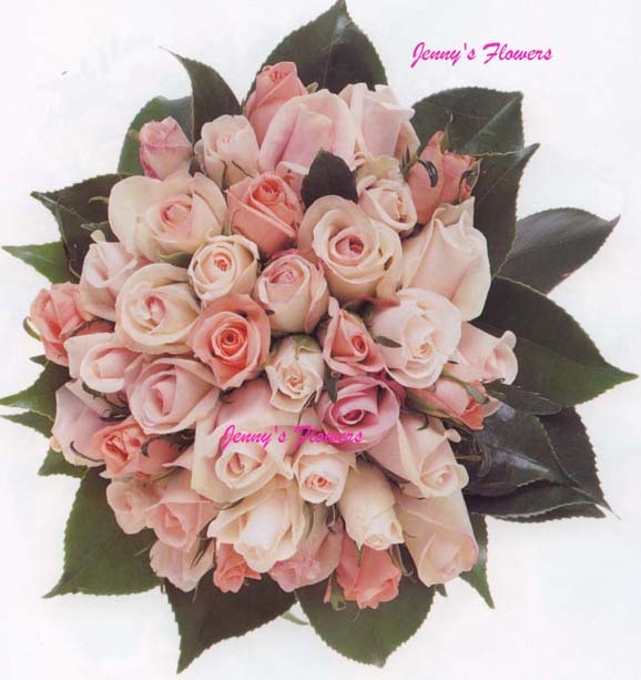 {A beautiful formal posy with Bianca Candy roses, Emma roses, Amarosa roses, Pretty Woman roses, and Camellia leaves}