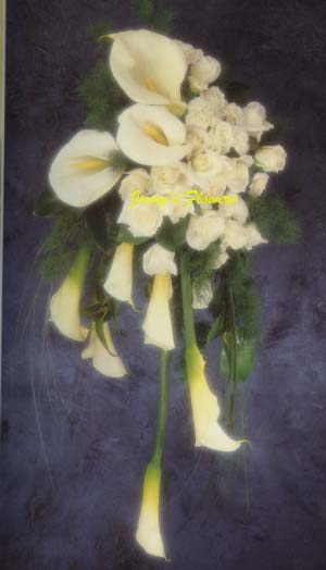 {Contemporary style with white Calla Lilies clustered with white Roses and Ming Fern.}