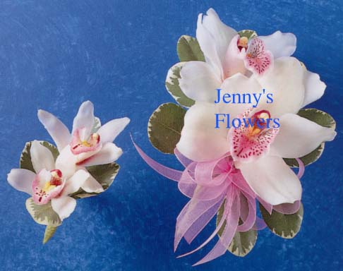 {Corsage and Boutonniere with elegant cymbidium orchid with sheer ribbon }
