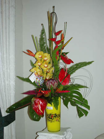{Tropical Arrangements with Heliconia, Anthurium, Red Ginger, Canna, and foliages include: Dieffenbachia, Philodendron, and Ti Leaves. }