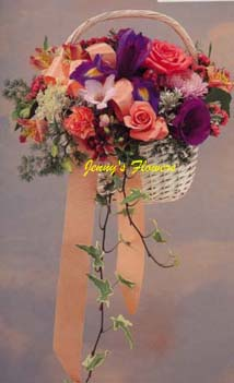 {Lovely flower Basket Bouquet with roses, Freesia, Iris, Alstroemeria,, Statice, and Queen Anne's Lace is complemented with Ivy Strands}