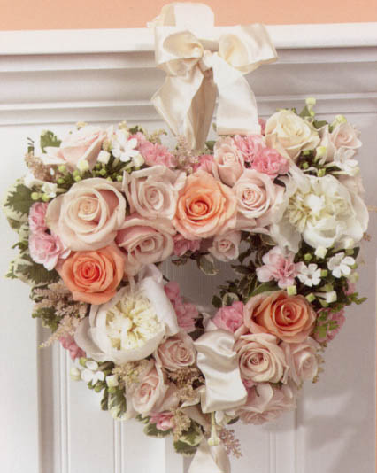 {Heart filled with mixed roses for reception table}