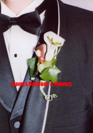 {Groom's second Boutonniere with miniature Calla Lilies and Galax leaf wrapped for contemporary look}