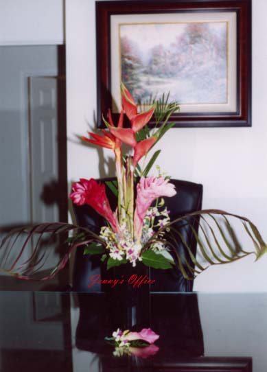 {This is Jenny's office arrange with tropical arrangement}