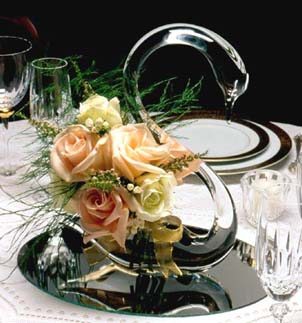 {A Swan Vase is perfect for the Guest's table}